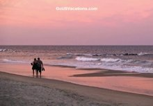 Couple doing a Sunset Walk on Beach