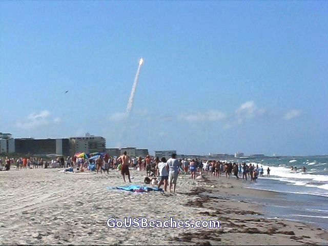 Crowd watching Space Shuttle Launch from beach at Cocoa Beach Florida June 2008