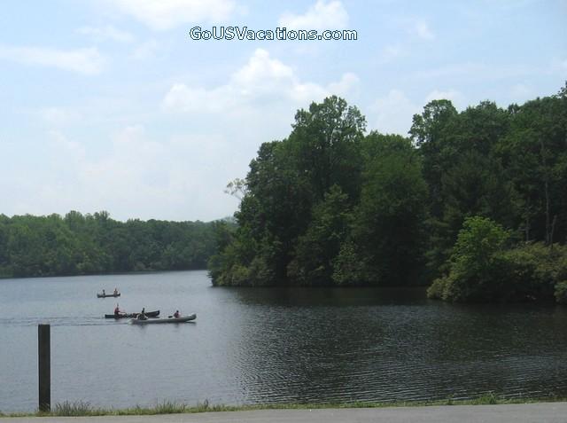 Canoes racing in Julian Price Park Lake