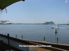 View of Cruise Ships in Harbor from Millikens Reef outdoor dining deck.