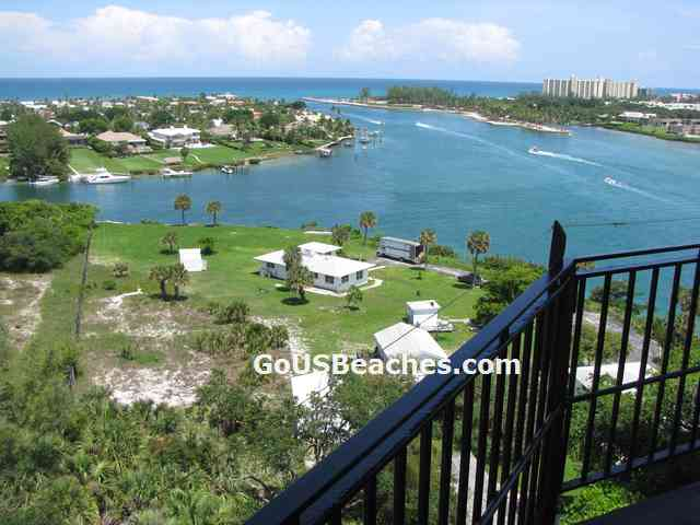 Busy Jupiter Inlet and Atlantic Ocean taken from open viewing deck at the top of the