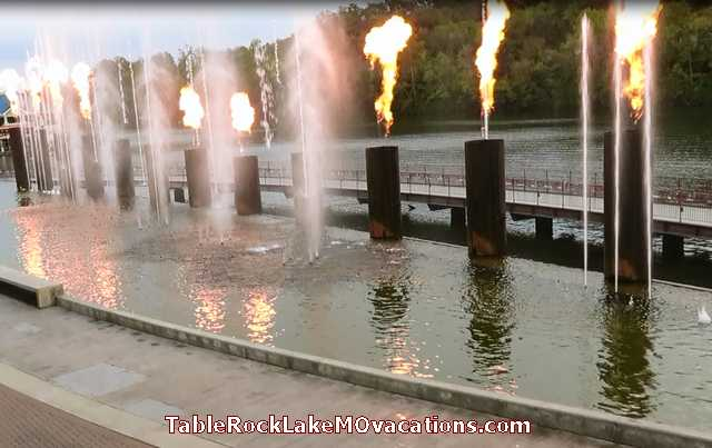 Branson Harbor waterfront restaurant outdoor dining view of narrow branch of Lake Taneycomo with Syncronized Music + Water Jets + Fire Plumes Show