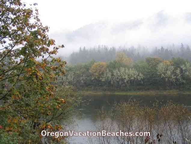 Oregon Autumn fog on mountains across river from McKenzie Hwy