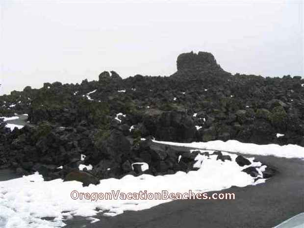 Lookout structure made of black volcanic rocks at Volcanic area peak