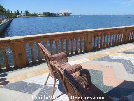 Chairs on back side of Ringling Mansion with a panaroma view of the Gulf