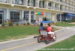 Virginia Beach Boardwalk - 4 wheeled bicycles were a big hit - could rent 2-4-and 6 peddler versions at many resorts up and down the strip - Virginia Beach Picture page