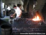 Colonial Williamsburg - Blacksmith pounding out hand made square nails - Near Virginia Beach Attraction