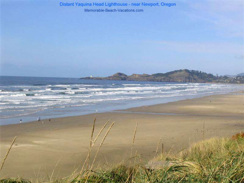 Sandy Beach from top of tall Sand Dune -Yaquina Head Lighthouse in distance