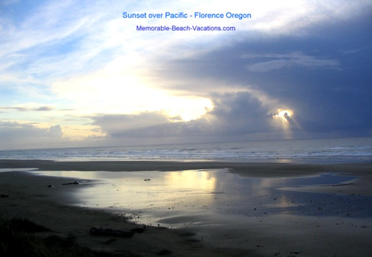 Beach Sunset over Pacific Ocean - Heceta Beach - Florence OR - Blue sky and clouds with a yellow reflection