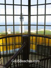 View from top of lighthouse enclosed glass area with bars.