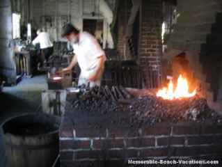 Colonial Williamsburg - Blacksmith pounding out square nails.